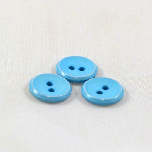 Gombík okrúhly svetlý modrý